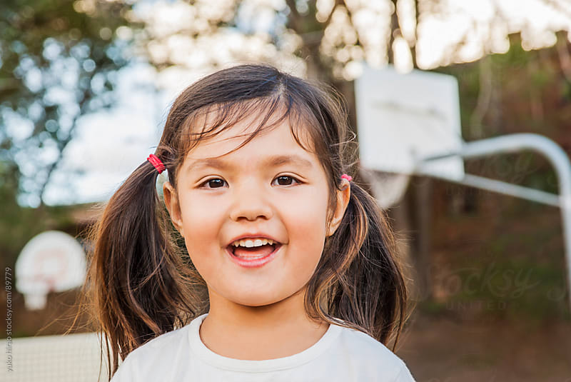 Asian Hispanic preschooler girl portrait at playground by yuko hirao for Stocksy United