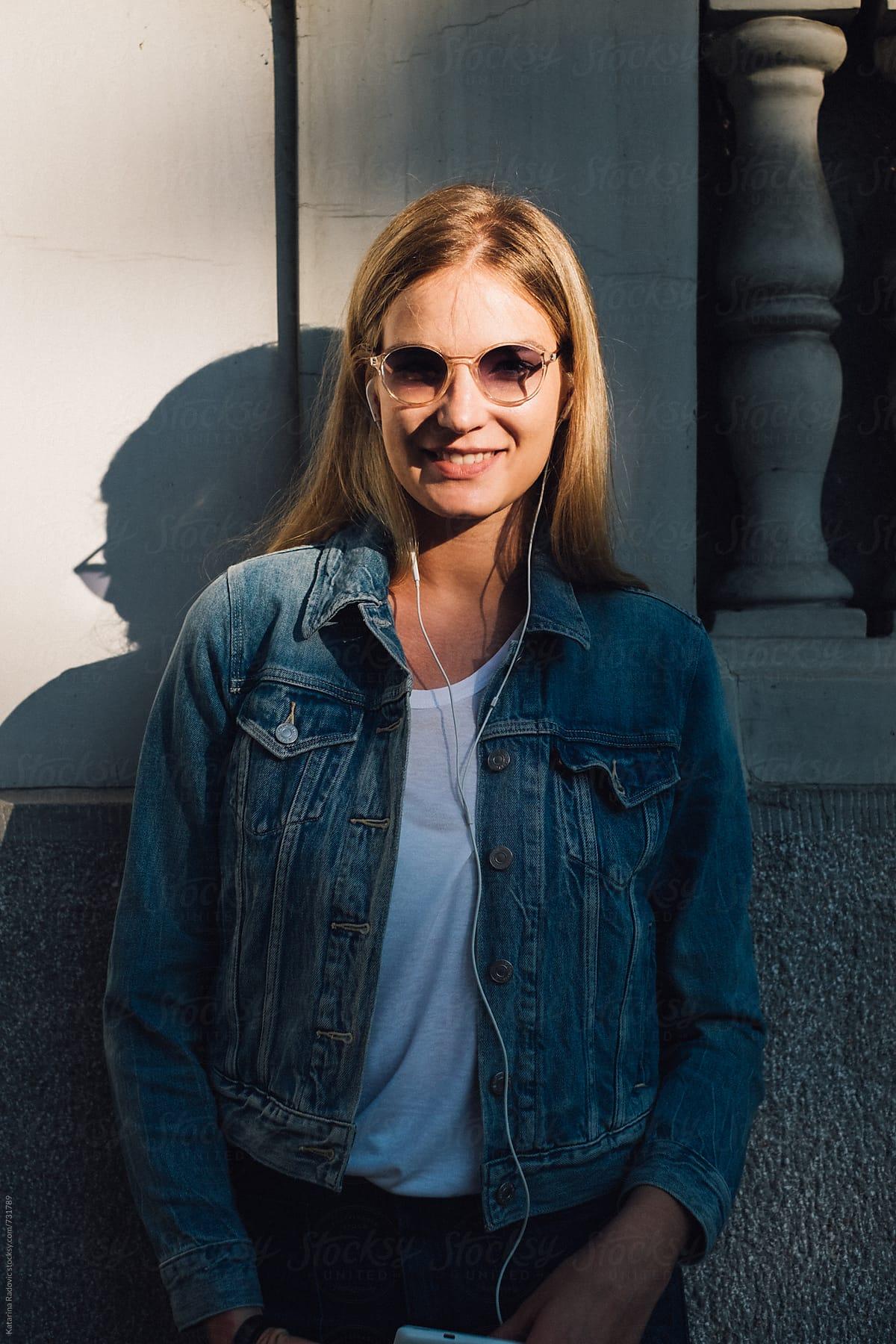 ed94653fa0 Portrait Of A Beautiful Blonde Woman Wearing Denim Jacket