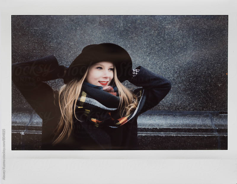 happy blond young woman with hat by Alexey Kuzma for Stocksy United