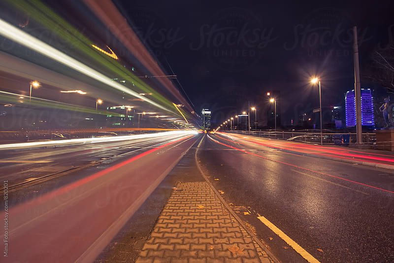 Light trails of traffic and street car in Germany by Michael Zwahlen for Stocksy United