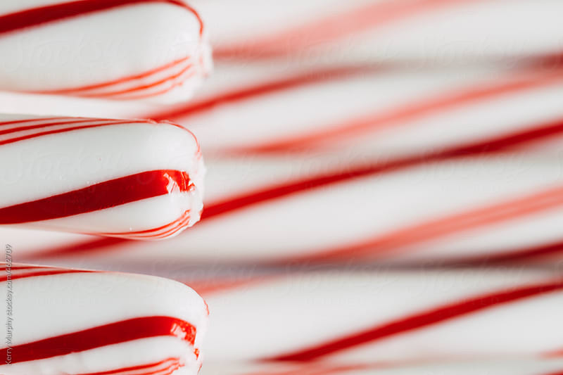 Partial peppermint striped candy canes by Kerry Murphy for Stocksy United