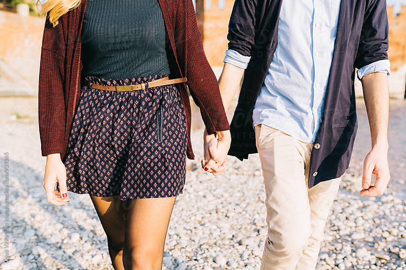 Couple holding hands outdoors by Good Vibrations Images for Stocksy United