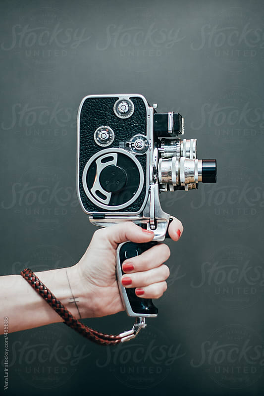Woman hand holding old film camera by Vera Lair for Stocksy United