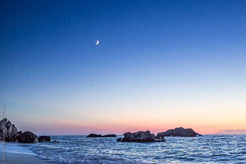 Rocky Seascape with Crescent Moon at Twilight by Helen Sotiriadis for Stocksy United