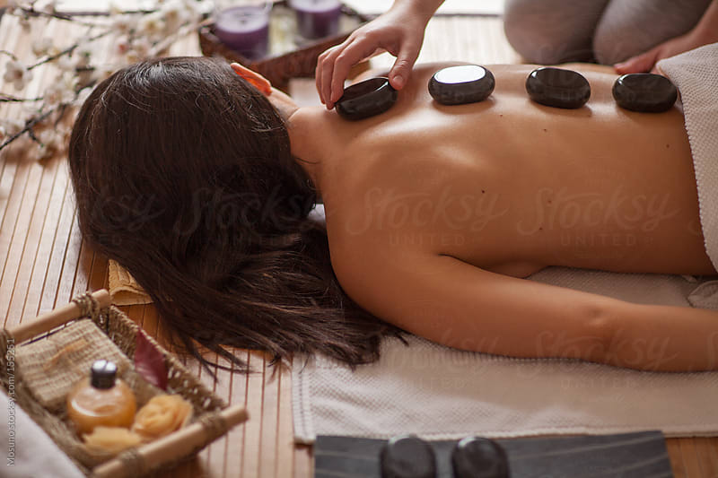 Woman Receiving Hot Stone Massage by Mosuno for Stocksy United