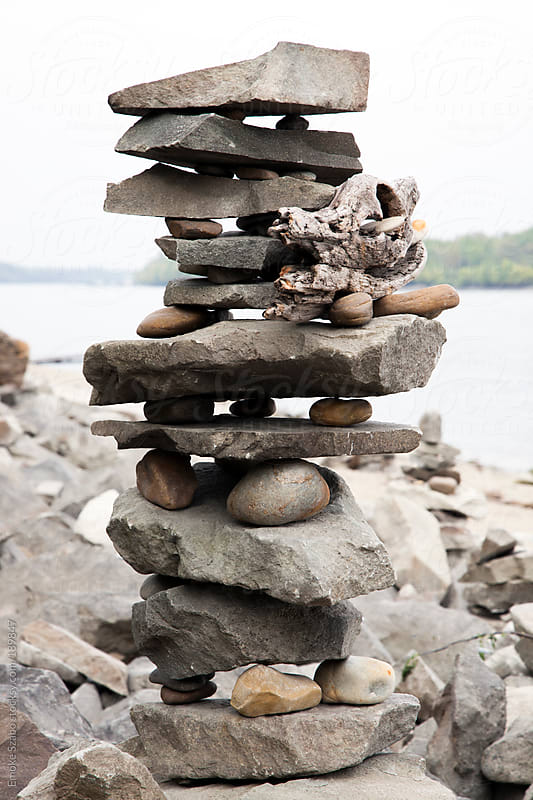 Sculpture symbol of different pebbles by Emoke Szabo for Stocksy United