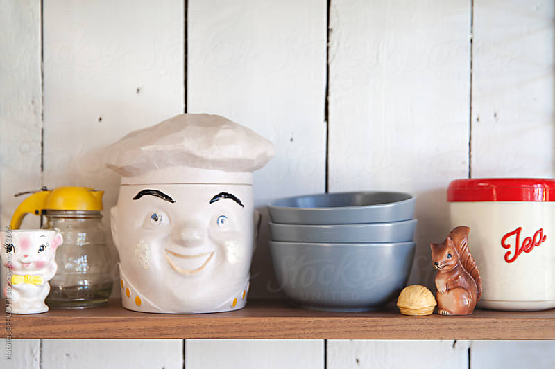 Shelf in a kitchen with fun retro items, bowls and canisters by Natalie JEFFCOTT for Stocksy United