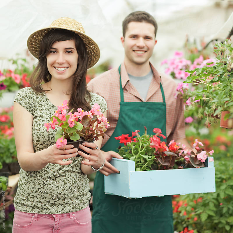 Nursery Garden Workers Holding Flowers by Lumina for Stocksy United