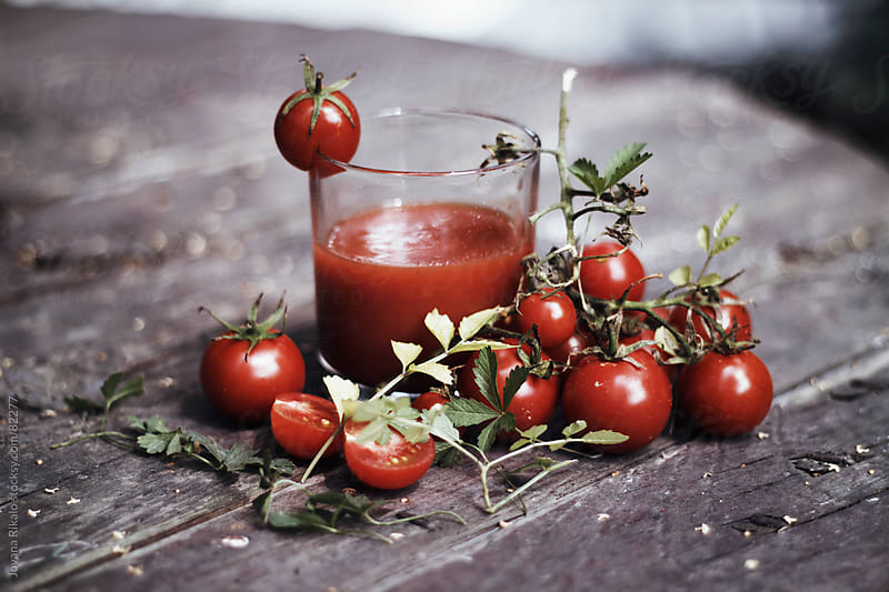 Tomato juice on wooden table by Jovana Rikalo for Stocksy United