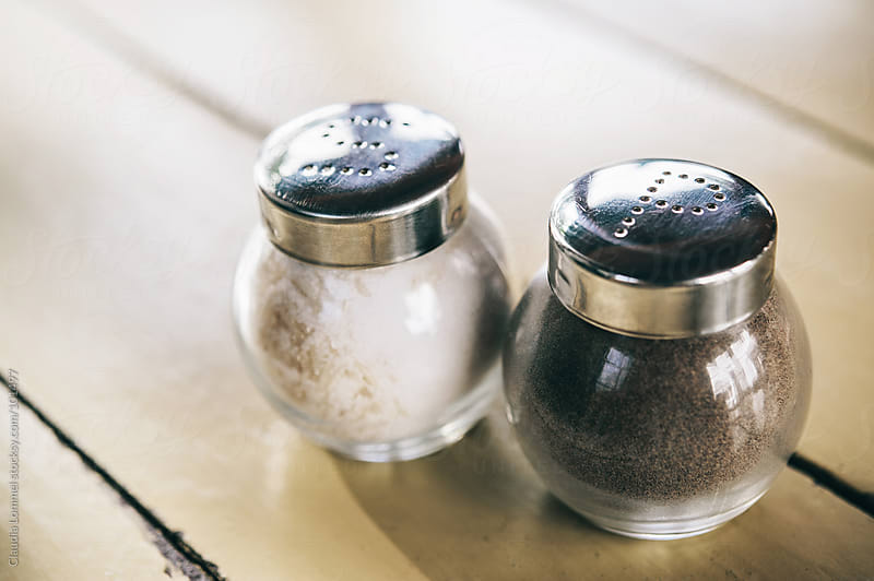 Salt 'n' Pepper Shakers on a Rustic Table by Claudia Lommel for Stocksy United