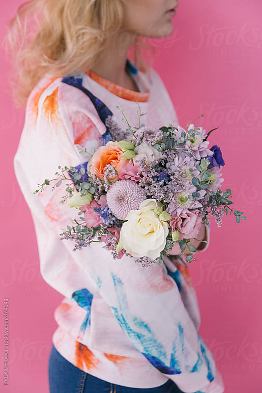 Side view of blonde woman holding beautiful bouquet by Danil Nevsky for Stocksy United