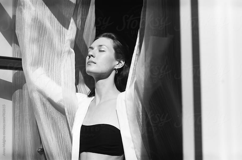 A black and white film portrait of a young beautiful  woman  by Anna Malgina for Stocksy United