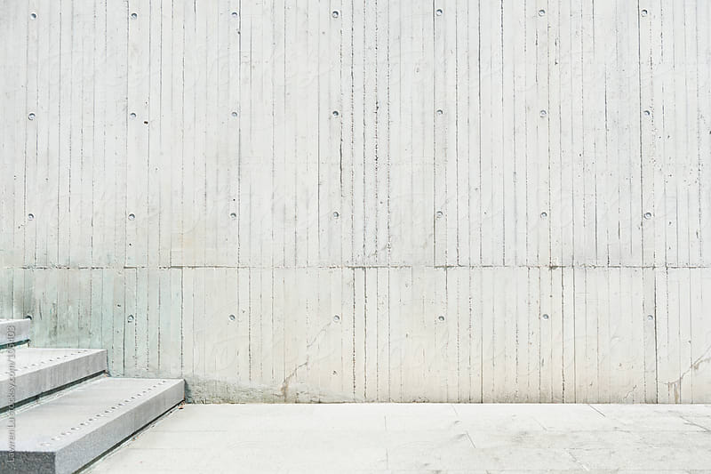 Exposed concrete wall with stairs by Lawren Lu for Stocksy United