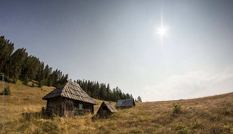 Traditional Serbian house on mountain meadow by Marko Milovanović for Stocksy United