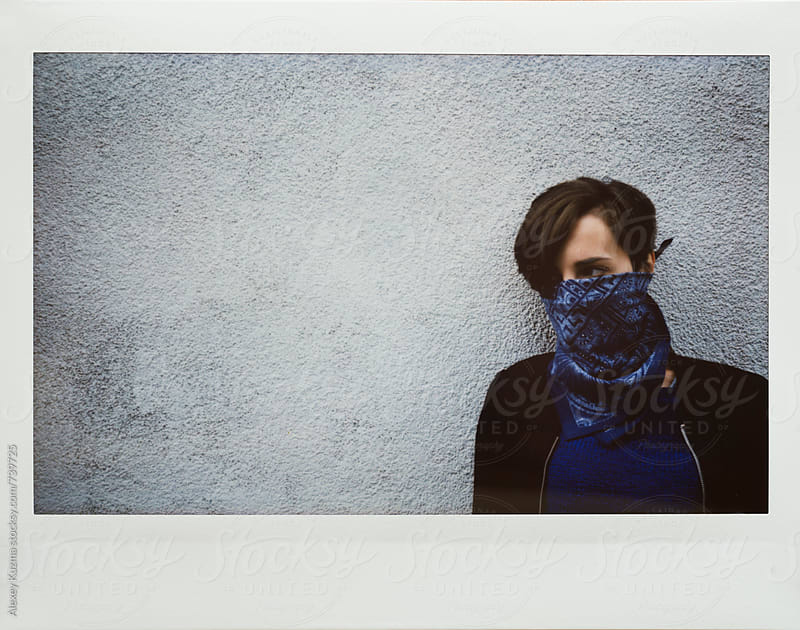 tomboy covered face with blue headscarf by Alexey Kuzma for Stocksy United