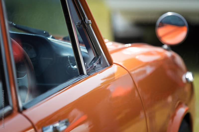 Photo of an orange car from close by Jason Hill for Stocksy United