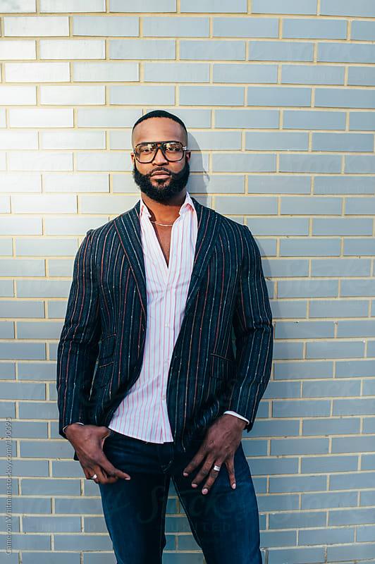 Bearded black man portrait in hard light by Cameron Whitman for Stocksy United