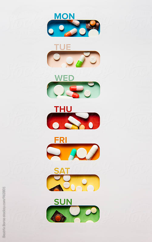 Medicine concept: medicine holder for each day of the week by Beatrix Boros for Stocksy United