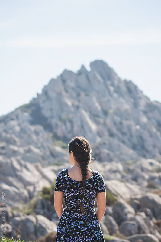 Woman looking at a mountain by Luca Pierro for Stocksy United