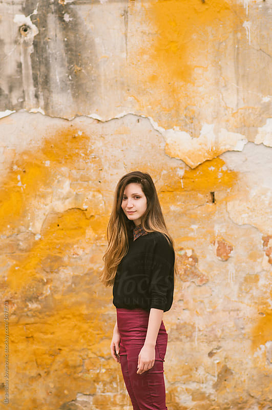 Beautiful Woman Standing in Front of Yellow Wall by Brkati Krokodil for Stocksy United