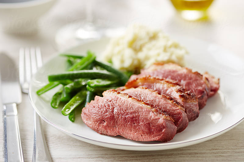 Duck breast with green beans and mashed potatoes by Martí Sans for Stocksy United
