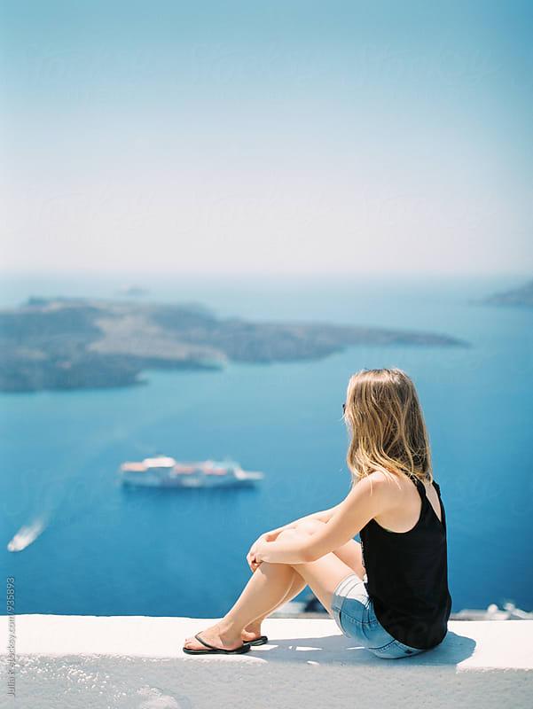 Woman enjoying landscape of Santorini, Greece by Julia K for Stocksy United