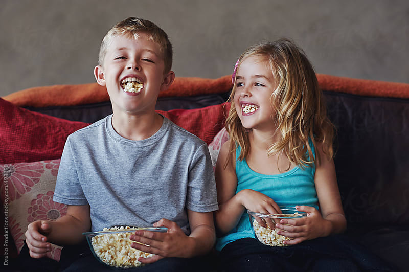 movie popcorn kids by Daxiao Productions for Stocksy United