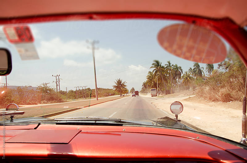 driving in Cuba by Tomas Kraus for Stocksy United