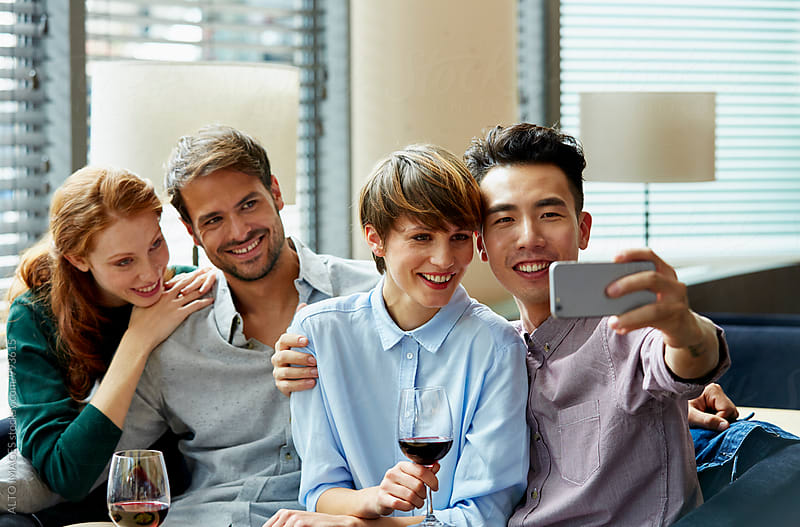 Happy Man Taking Selfie With Friends In Restaurant by ALTO IMAGES for Stocksy United