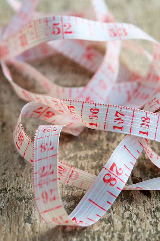 Measure tape by Harald Walker for Stocksy United