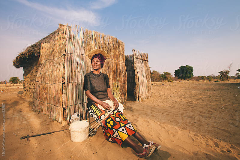 Portrait of an African Hambukushu woman by Micky Wiswedel for Stocksy United