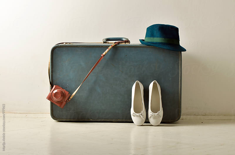 white flats ,old retro camera and hat lean on suitcase by Marija Anicic for Stocksy United