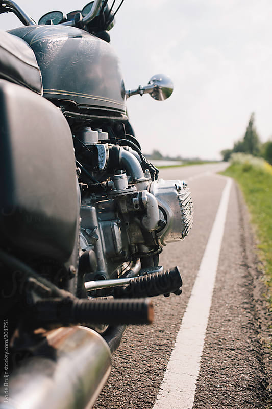 Classic motor standing on the road ready to ride by Ivo de Bruijn for Stocksy United