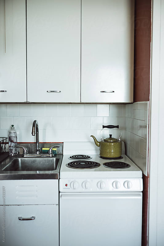 Small kitchen in a studio apartment by Kristine Weilert for Stocksy United