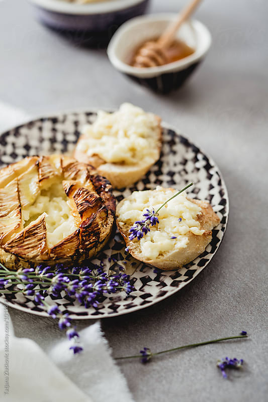 Baked camembert with honey and lavender by Tatjana Ristanic for Stocksy United