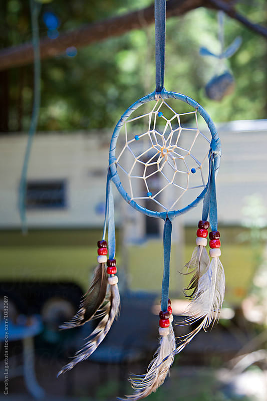 Dream catcher hanging at camp by Carolyn Lagattuta for Stocksy United