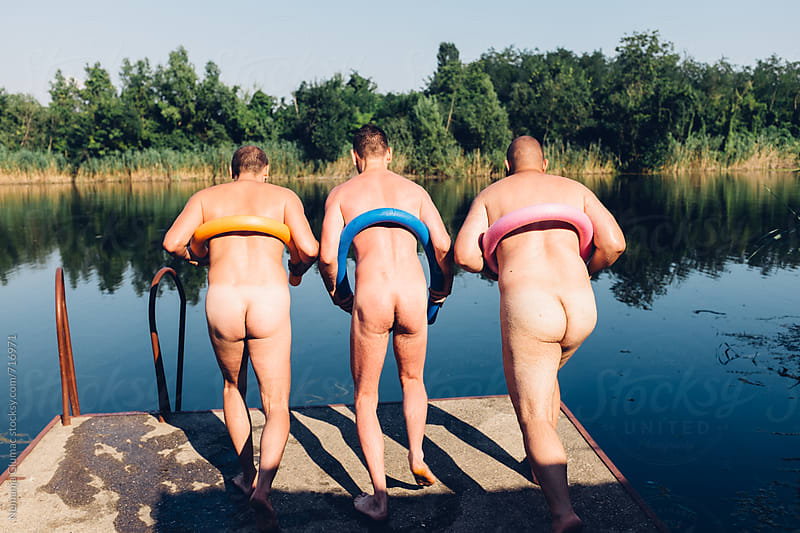 Three Naked Men Preparing to Jump Into the Lake by Nemanja Glumac for Stocksy United