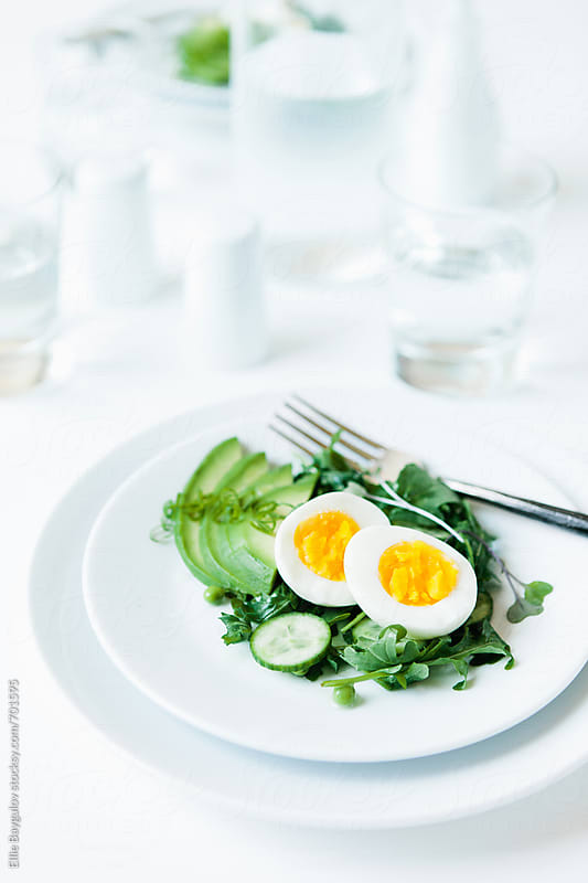 Fresh green salad with boiled egg by Ellie Baygulov for Stocksy United