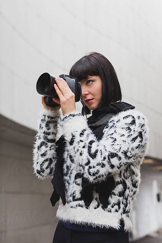 Female photographer at work by Mauro Grigollo for Stocksy United