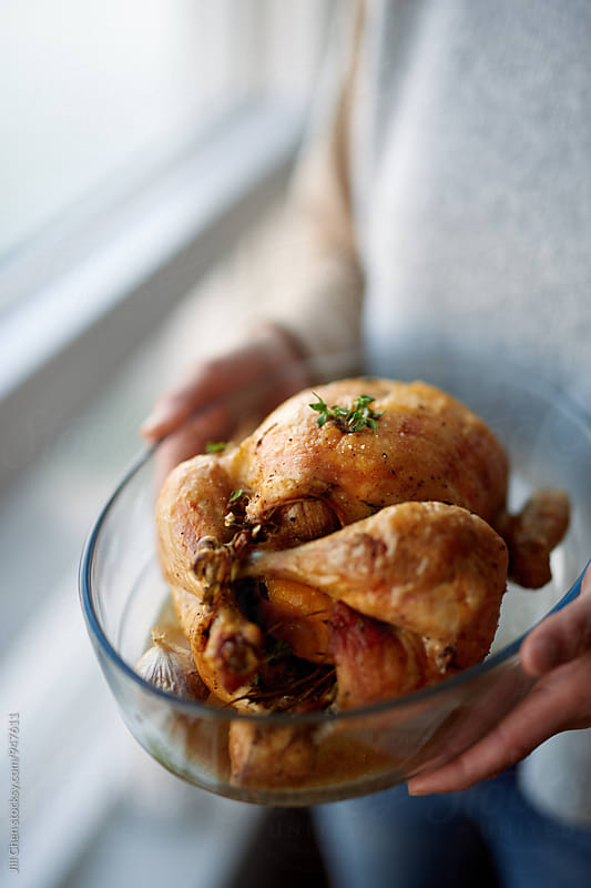 Golden roast chicken  by Jill Chen for Stocksy United