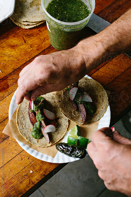 Tongue Tacos with hands by Andrew Cebulka for Stocksy United