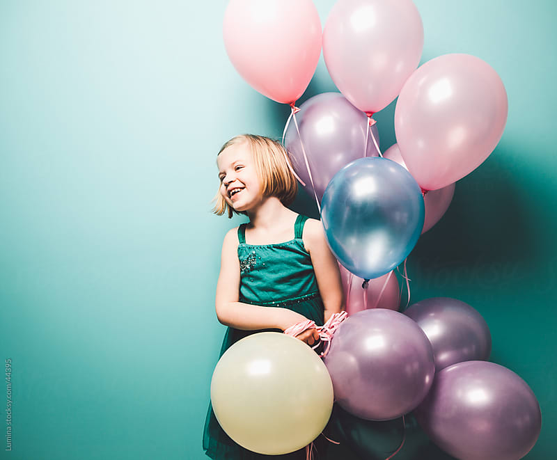 Girl Holding Ballons by Lumina for Stocksy United