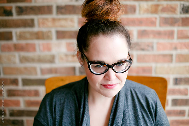 Beautiful woman with cat eye glasses by Jennifer Brister for Stocksy United