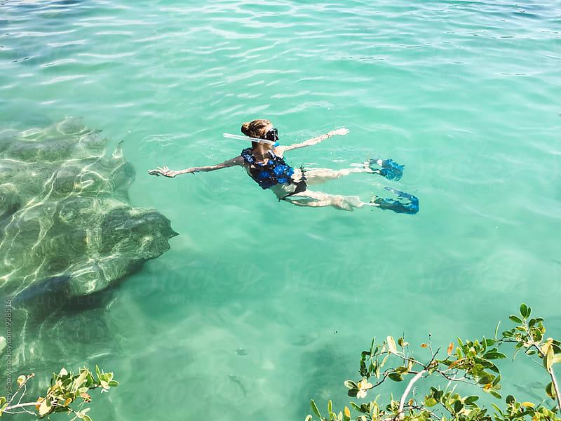 Snorkeling in ocean water by Carey Shaw for Stocksy United