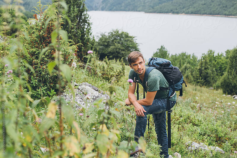 Young explorer hiking in the mountains by Jovo Jovanovic for Stocksy United