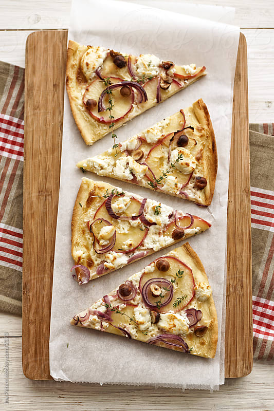 Apple and Goat Cheese Pizza by Ina Peters for Stocksy United