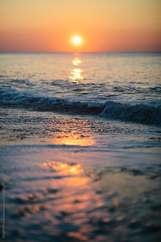 Sunrise over the sea by Kirstin Mckee for Stocksy United
