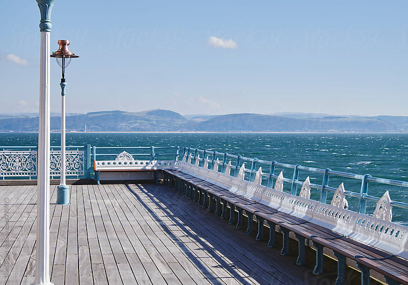 Lamp and seating on Mumbles Pier. Wales, UK. by Liam Grant for Stocksy United