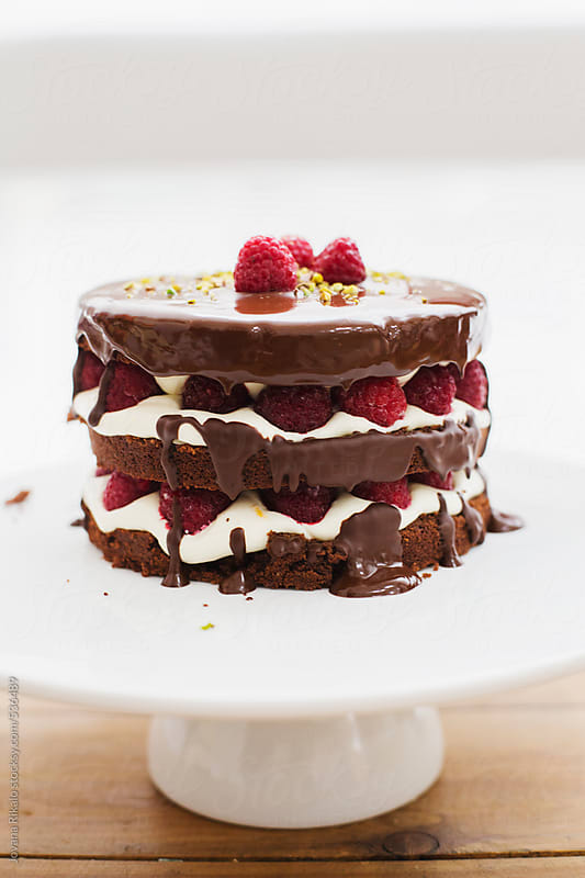 Chocolate cake with raspberries and lemon cream close up by Jovana Rikalo for Stocksy United