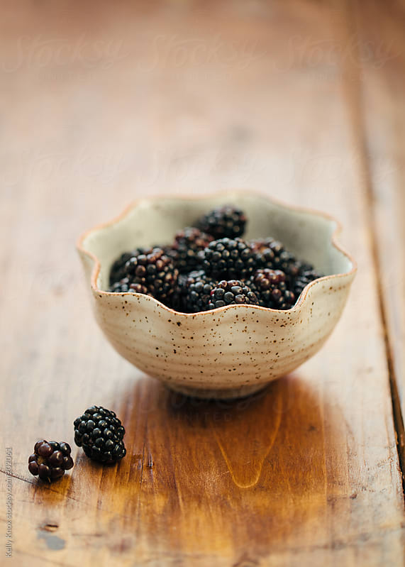 blackberries in a bowl by Kelly Knox for Stocksy United